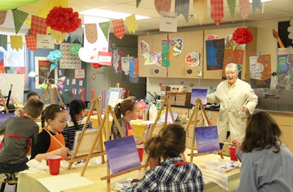 Cartmell students paint using easels.