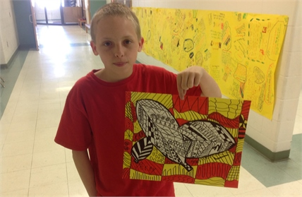 Student showing his artwork